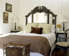 A dresser mirror repurposed as a headboard