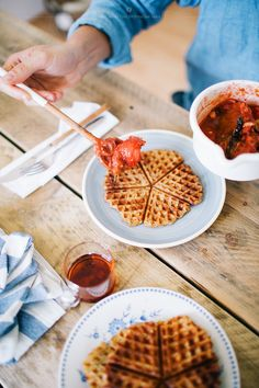 Waffles with vanilla rhubarb strawberry sauce.