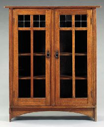 OAK TWO-DOOR BOOKCASE  HARVEY ELLIS FOR GUSTAV STICKLEY, CIRCA 1905