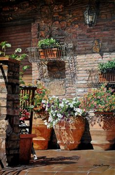 Charming Tuscan Porch with rustic weathered planters overflowing with beautiful flowers!