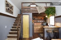 Add a loft over your kitchen. | 31 Tiny House Hacks To Maximize Your Space