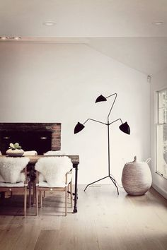 Cozy dining room with Serge Mouille floor lamp.