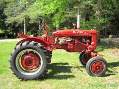 A red McCormick Farmall tractor on the grounds of the Bucklin! Donated by the friends of Troop 4 Barrington, Rhode Island.  At Camp #Yawgoog, Rockville, Hopkinton, Rhode Island (RI).  A 2014 image by David R. Brierley.