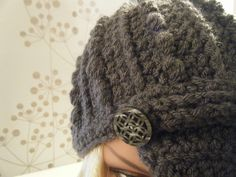 Cabled crochet hat.