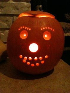 carving a pumpkin with a drill