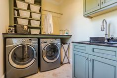 ... Laundry room features a built-in washer and dryer with granite