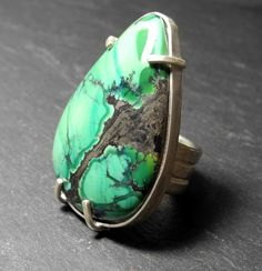 Green turquoise claw set ring