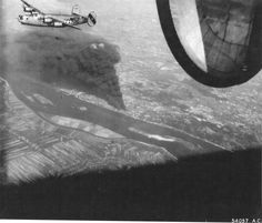 B-24J Liberator of the 856th Bomb Squadron over the target of the Rhenania-Ossag oil refinery near Hamburg, Germany, Aug 6 1944. (US National Archives)