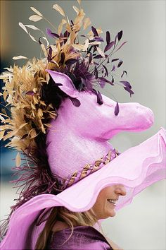 Derby Day hat...whoa...how do those ladies do it?  i bet their necks are sore for days after the derby!