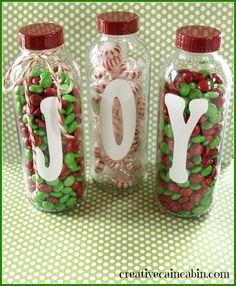 Fill recycled glass bottles with festive holiday candy.  Vinyl letter cut with Silhouette machine.