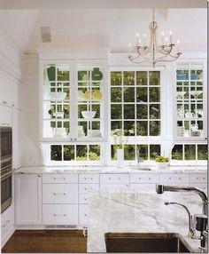 Beautiful all-white kitchen with glass WINDOW cabinets and backsplash.
