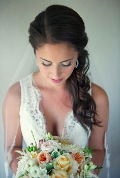 Love this bride's romantic, side-swept hairstyle & lace wedding dress. Beach Chic Wedding by Carla Ten Eyck Photography http://su.pr/1o6pKI