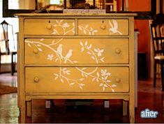 painted yellow dresser with bird & branch