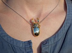 Stag beetles are amazing creatures. They look like tiny knights in full armor. I think there a not many left of this brave soldiers ... I saw my last stag beetle when I was a kid! This stag beetle can be used as a pendant! Manufactured via i.materialise.com 3d printing service.
