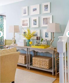 2 matching tables with baskets, chairs on either side, spaced out art, all the same frames but different shaped matting