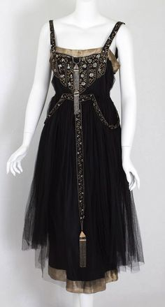 French beaded evening dress, black tulle over a black satin lining, 1918, via Vintage Textile.