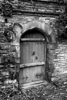 This is an old door in the churchyard at Holy Trinity Church in Stratford-on-Avon. William Shakespeare's grave is in the church.