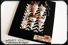 Great to use for pre-Halloween candy station. Keep the kids away from the halloween candy. Created from Spooky Junque Candy Cones kit. Cones are adhered to paper then framed.
