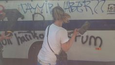 #occupygezi A protester strikes a police vehicle