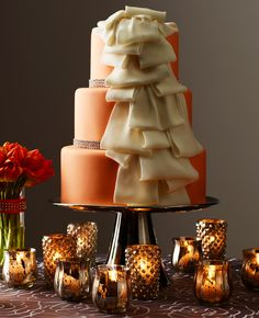 Halloween themed wedding cake with a cascading orange fondant ribbon. Perfect for your fall wedding, or change the colors and use the idea for a rustic wedding. add a burlap bow, perhaps? Cake by David Prince