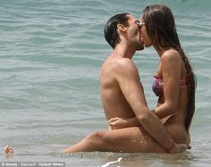Adrien Brody and girlfriend Lara Leito share a passionate kiss in the ocean during a vacation in Hawaii on Sunday .
