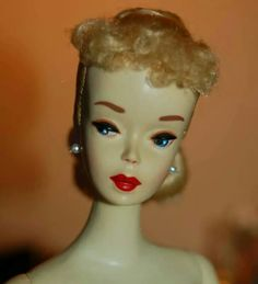 Closeup of a #1 hand painted Barbie from the collection of Rosemary Allen.