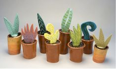 Love this idea! Clay cylinders with a made up clay slab plant!