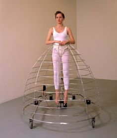 She used rollers on the bottom to make the cage less weight to carry on her own smart modern day trick