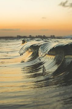 Perfect timing of waves cresting. - Imgur