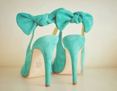 green suede shoes with bows at heel