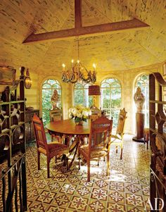 Our eyes are on the cement tile floor of this dining room of a retreat compound in Mount Desert Island, Maine.
