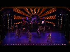 "This wonderful big production number is the finale from the Tony Award-winning revue ""Fosse"". This is part 1 of 2.    Louis Prima's 1936 composition ""Sing Sing Sing"" became one of his biggest hits and one of the most covered standards of the swing era; Benny Goodman's performance of the song at Carnegie Hall with a featured performance by Gene Krupa on drums has become iconic.    From the highly recommended 2002 DVD ""Fosse"". View excerpts easily at http://www.theBestArts.com/Fosse/ jazz danc, band era, signatur color, music fan, big band"