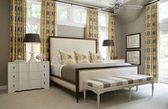 Crestwood - Tobi Fairley Interior Design. In the master, the bed is from Hickory Chair, the bedside chests are Oly, the yellow fabric is from Duralee, and the linens are Matouk.