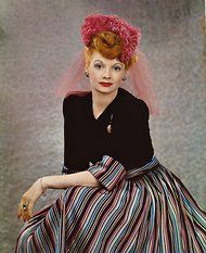 i am coveting lucy's hat - saturated red violet with her what's not to like ginger coiffure