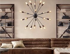 really extravagant for a small living room but wowee... an atomic filament chandelier...