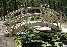 Arched garden bridge