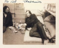 Actor Jack Nicholson relaxes between takes on the set of The Shining, joined by director Stanley Kubrick, in this production continuity Polaroid.