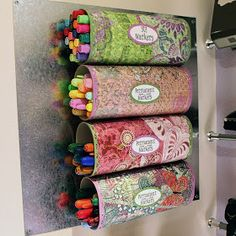 Great idea for storing dry erase markers or crayons!  Made from Crystal Light containers!