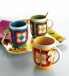 plain mugs covered with wrap around crochet cozies.