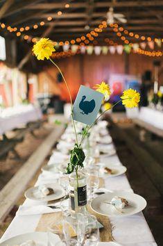farm animal table numbers, photo by Sara Wilde http://ruffledblog.com/pucks-farm-wedding #weddingideas #tablenumbers