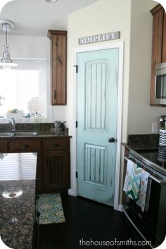 Paint the pantry door an accent color and it adds lots of style to the kitchen.