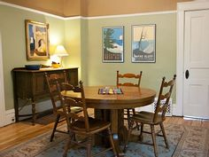 at our cottage: spacious dining room features vintage style posters by Glen Clark; oak table with 3 more leaves & chairs to seat up to 10.