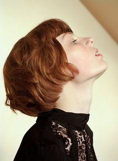 Short red hair.