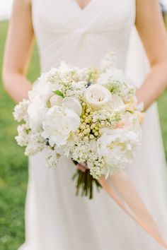 all-white bouquet, photo by L. Hewitt Photography http://ruffledblog.com/19th-century-stone-house-inspiration #flowers #weddingbouquet