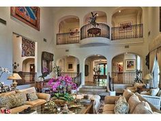 A Romeo and Juliet balcony make this stylish and lavish living room even more extravagant.  Los Angeles, CA Coldwell Banker Residential Brokerage $24,950,000