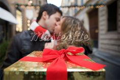 Couple Kissing, Close-up of Christmas Present