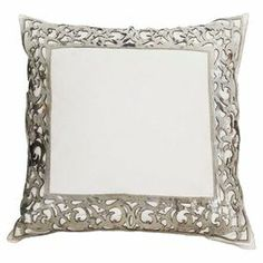 White cotton pillow with a silvered cowhide cutout trim.  Product: PillowConstruction Material: Cotton and cowhide coverColor: White and silverFeatures: Insert includedCleaning and Care: Dry clean only