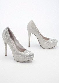 """Be the talk of the town in these out-of-this-world crystal platforms!  High heel glitter mesh platform pumpfeatures sparkling crystal detail.  Heel measures 5"""". Platform measures 1"""".  Fully lined. Imported."""