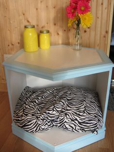 Upcycle an old style end table (with one or both doors removed) into a pet hideaway.