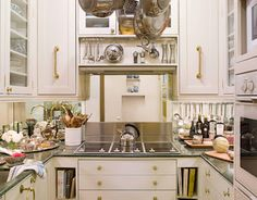 Love love the mirrored backsplash in this small kitchen